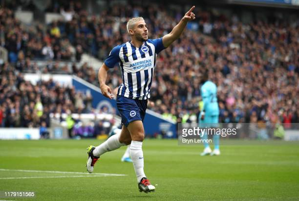Neal Maupay of Brighton and Hove Albion celebrates after he scores his sides first goal during the Premier League match between Brighton Hove Albion...