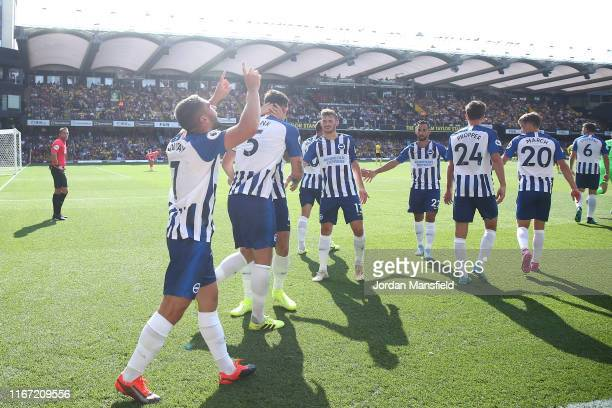 Neal Maupay of Brighton and Hove Albion celebrates after scoring his team's third goal during the Premier League match between Watford FC and...