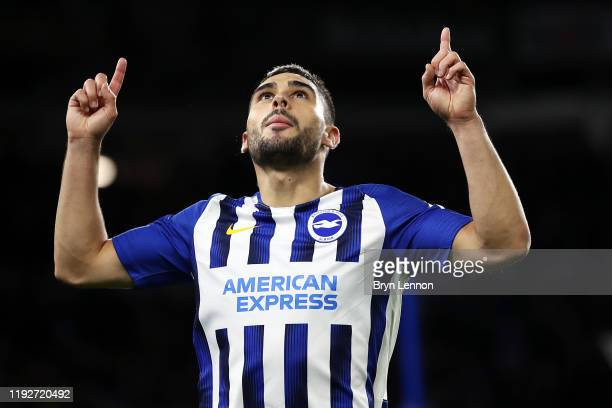 Neal Maupay of Brighton and Hove Albion celebrates after scoring his team's first goal during the Premier League match between Brighton Hove Albion...