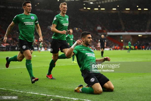 Neal Maupay of Brighton and Hove Albion celebrates after scoring his team's first goal during the Premier League match between Sheffield United and...