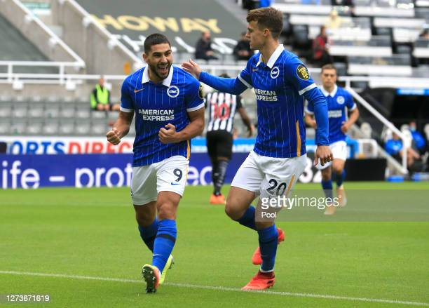 Neal Maupay of Brighton and Hove Albion celebrates after scoring his team's first goal during the Premier League match between Newcastle United and...
