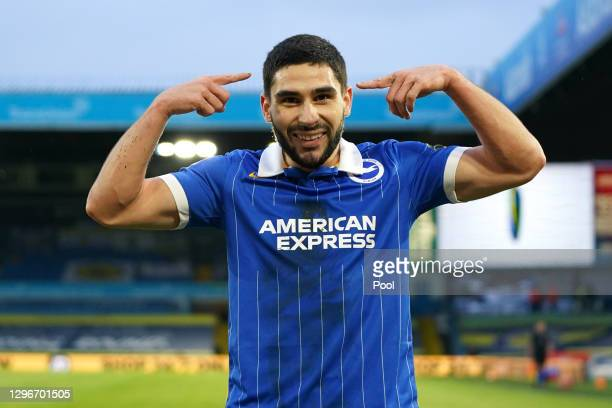 Neal Maupay of Brighton and Hove Albion celebrates after scoring his team's first goal during the Premier League match between Leeds United and...