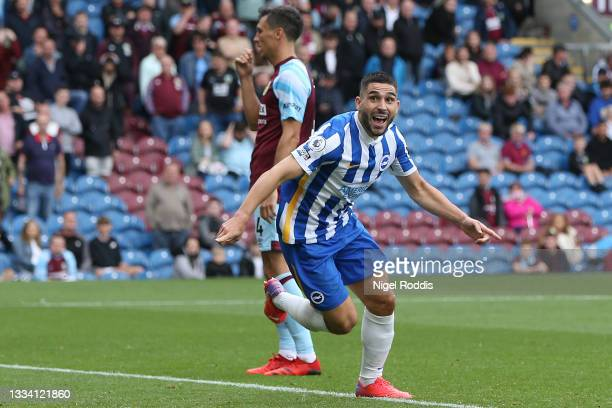 Neal Maupay of Brighton and Hove Albion celebrates after scoring their side's first goal during the Premier League match between Burnley and Brighton...