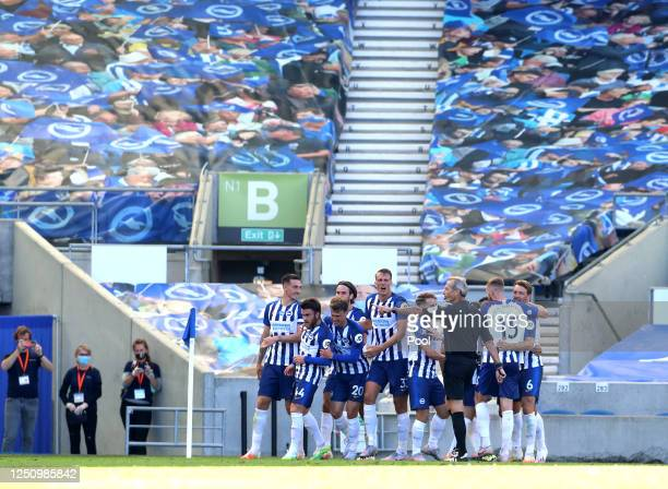 Neal Maupay of Brighton and Hove Albion celebrates with his team mates after scoring his team's second goal during the Premier League match between...