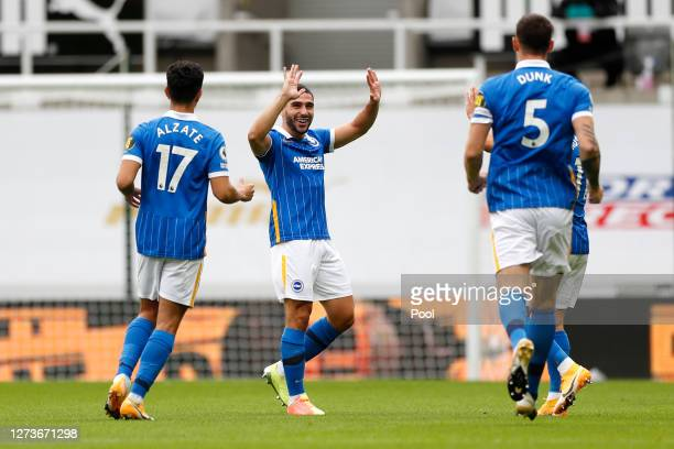 Neal Maupay of Brighton and Hove Albion celebrates with teammates after scoring his sides second goal during the Premier League match between...