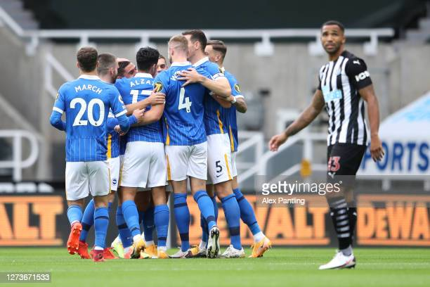 Neal Maupay of Brighton and Hove Albion celebrates with teammates after scoring his team's second goal during the Premier League match between...