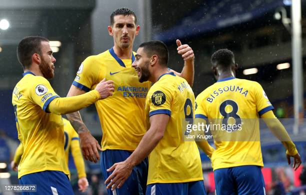 Neal Maupay of Brighton and Hove Albion celebrates with teammates after scoring his sides first goal during the Premier League match between Everton...