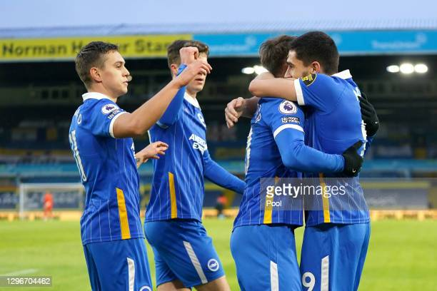 Neal Maupay of Brighton and Hove Albion celebrates with teammates after scoring his team's first goal during the Premier League match between Leeds...