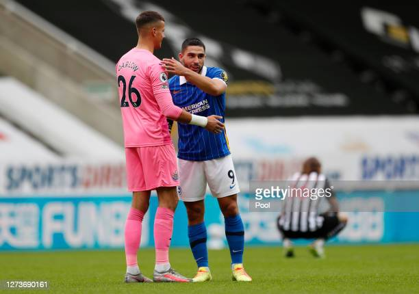 Neal Maupay of Brighton and Hove Albion consoles Karl Darlow of Newcastle United following Brighton and Hove Albion's victory in the Premier League...