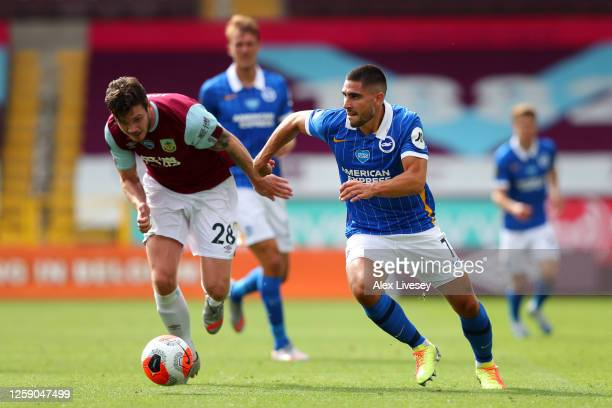 Neal Maupay of Brighton and Hove Albion controls the ball away rom Kevin Long of Burnley during the Premier League match between Burnley FC and...
