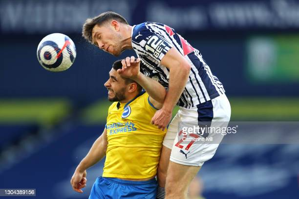 Neal Maupay of Brighton and Hove Albion is challenged by Dara O'Shea of West Bromwich Albion during the Premier League match between West Bromwich...