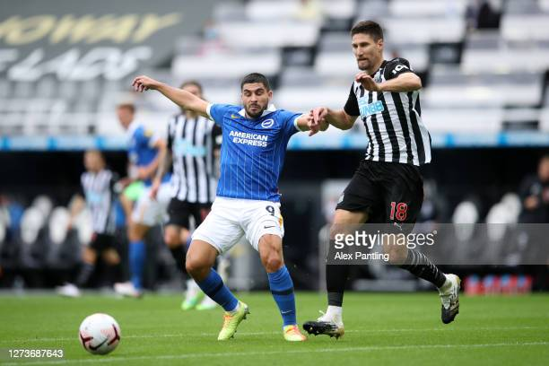 Neal Maupay of Brighton and Hove Albion is challenged by Federico Fernandez of Newcastle United during the Premier League match between Newcastle...
