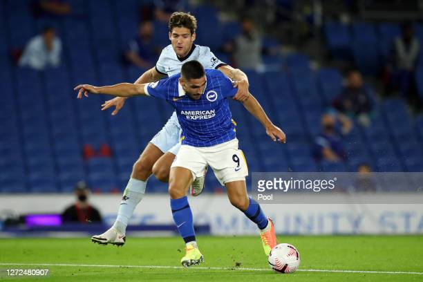 Neal Maupay of Brighton and Hove Albion is challenged by Marcos Alonso of Chelsea during the Premier League match between Brighton Hove Albion and...