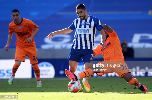 Neal Maupay of Brighton and Hove Albion is tackled by Danny Rose of Newcastle United during the Premier League match between Brighton Hove Albion and...