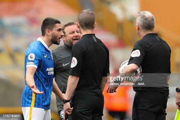 Neal Maupay of Brighton and Hove Albion receives a straight red card from Referee Jonathan Moss at full time for discent during the Premier League...