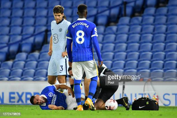Neal Maupay of Brighton and Hove Albion receives medical attention during the Premier League match between Brighton Hove Albion and Chelsea at...