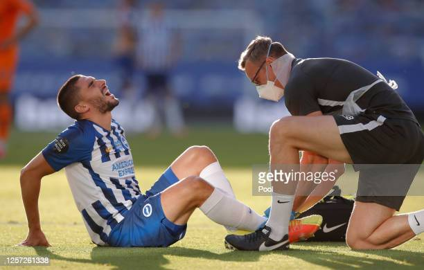 Neal Maupay of Brighton and Hove Albion receives medical treatment during the Premier League match between Brighton Hove Albion and Newcastle United...