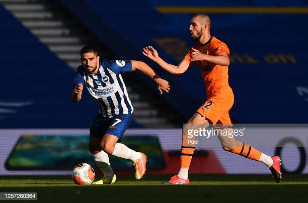 Neal Maupay of Brighton and Hove Albion runs past Nabil Bentaleb of Newcastle United during the Premier League match between Brighton Hove Albion and...