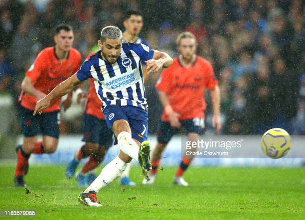 Neal Maupay of Brighton and Hove Albion scores a penalty for his team's second goal during the Premier League match between Brighton Hove Albion and...