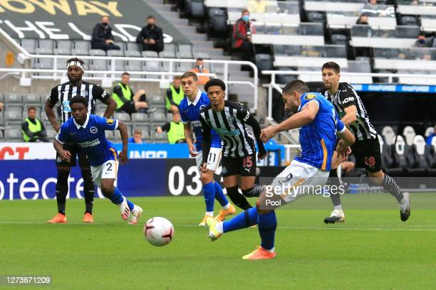 Neal Maupay of Brighton and Hove Albion scores a penalty for his team's first goal during the Premier League match between Newcastle United and...
