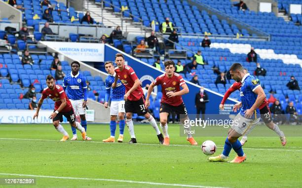 Neal Maupay of Brighton and Hove Albion scores a penalty for his team's first goal during the Premier League match between Brighton & Hove Albion and...