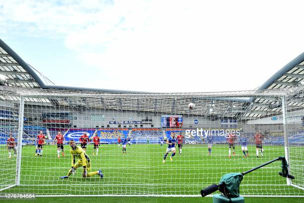 Neal Maupay of Brighton and Hove Albion scores a penalty for his team's first goal past David De Gea of Manchester United during the Premier League...