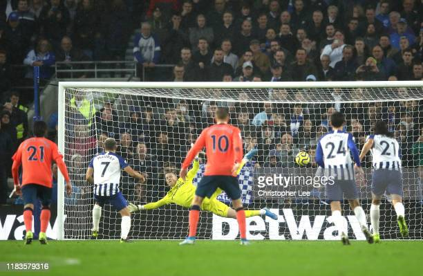 Neal Maupay of Brighton and Hove Albion scores a penalty past Jordan Pickford of Everton for Brighton and Hove Albion's second goal during the...