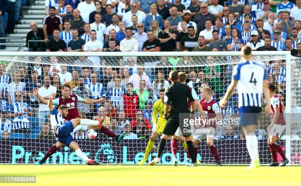 Neal Maupay of Brighton and Hove Albion scores his team's first goal during the Premier League match between Brighton & Hove Albion and Burnley FC at...