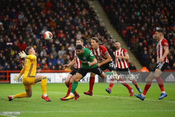 Neal Maupay of Brighton and Hove Albion scores his team's first goal during the Premier League match between Sheffield United and Brighton Hove...