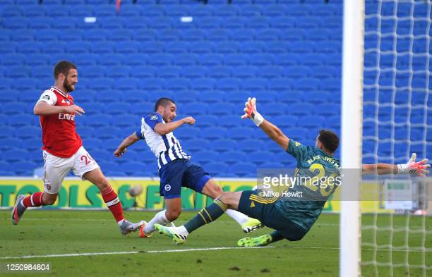 Neal Maupay of Brighton and Hove Albion scores his team's second goal past Emiliano Martinez of Arsenal during the Premier League match between...