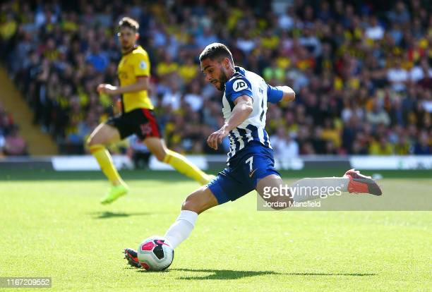 Neal Maupay of Brighton and Hove Albion scores his team's third goal during the Premier League match between Watford FC and Brighton & Hove Albion at...