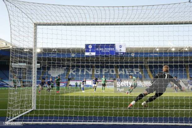 Neal Maupay of Brighton and Hove Albion takes a penalty kick and the shot is saved by Kasper Schmeichel of Leicester City during the Premier League...