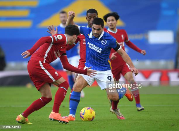 Neal Maupay of Brighton and Hove Albion takes on Neco Williams and Georginio Wijnaldum of Liverpool during the Premier League match between Brighton...
