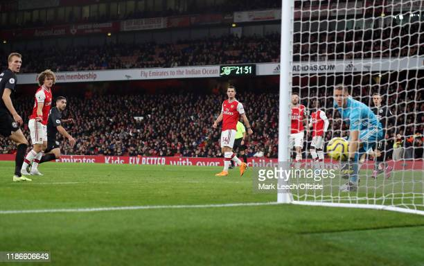Neal Maupay of Brighton heads the second goal for his team during the Premier League match between Arsenal FC and Brighton Hove Albion at Emirates...