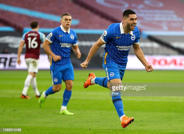 Neal Maupay of Brighton & Hove Albion celebrates after scoring their team's first goal during the Premier League match between West Ham United and...