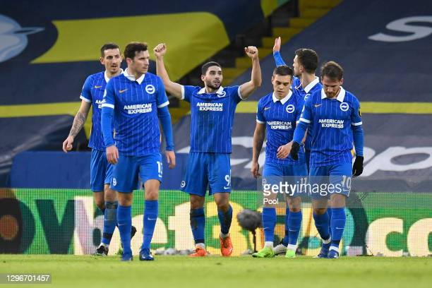 Neal Maupay of Brighton & Hove Albion celebrates with team mates after scoring their side's first goal during the Premier League match between Leeds...