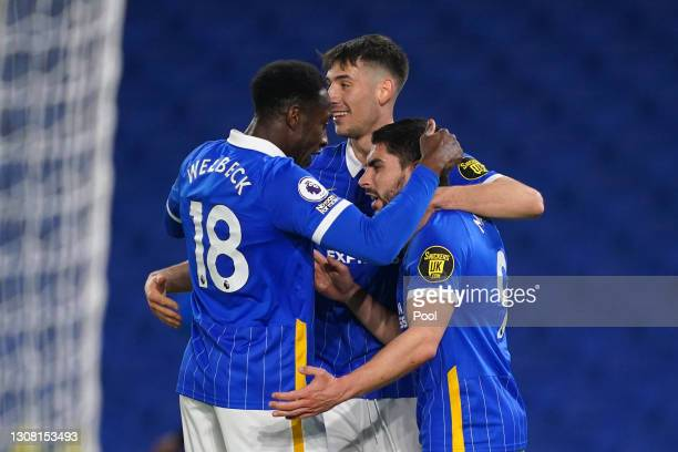 Neal Maupay of Brighton & Hove Albion celebrates with teammates Danny Welbeck and Jakub Moder after scoring his team's third goal during the Premier...