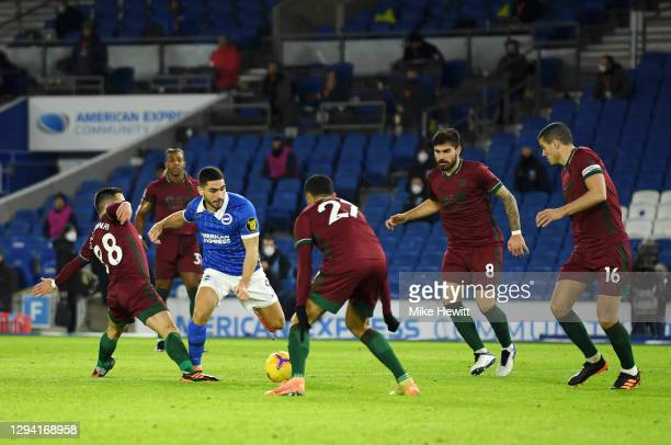 Neal Maupay of Brighton & Hove Albion is fouled by Joao Moutinho of Wolverhampton Wanderers in the box leading to a penalty decision during the...
