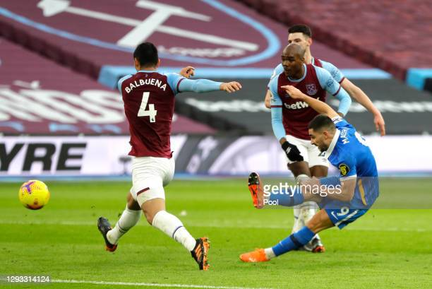 Neal Maupay of Brighton & Hove Albion scores their team's first goal during the Premier League match between West Ham United and Brighton & Hove...