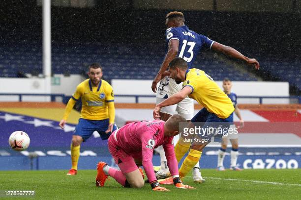 Neal Maupay scores his sides first goal during the Premier League match between Everton and Brighton Hove Albion at Goodison Park on October 03 2020...
