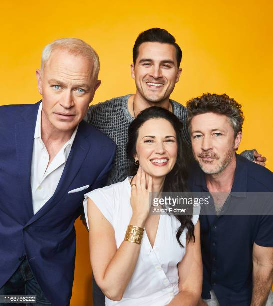 Neal McDonough Michael Malarkey Laura Mennell and Aidan Gillen of 'Project Blue Book' pose for a portrait at the Pizza Hut Lounge at 2019 ComicCon...