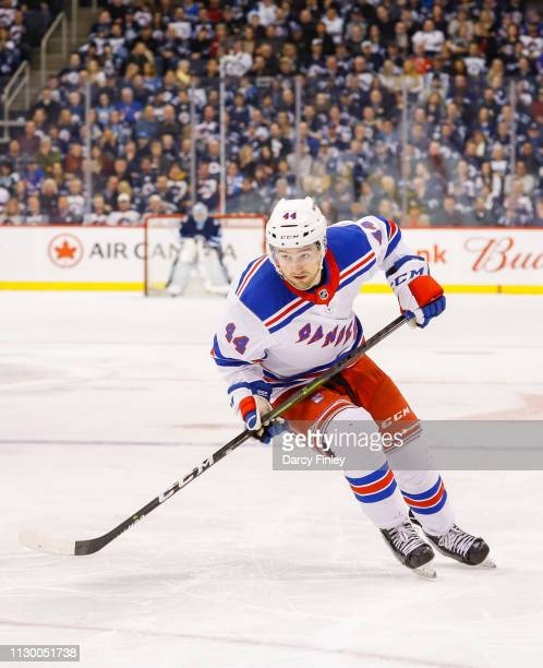 Neal Pionk of the New York Rangers follows the play down the ice during second period action against the Winnipeg Jets at the Bell MTS Place on...
