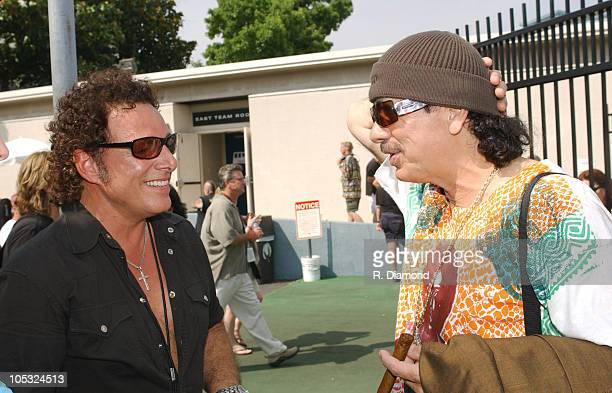 Neal Schon and Carlos Santana during Crossroads Guitar Festival Day Three Backstage at Cotton Bowl Stadium in Dallas Texas United States