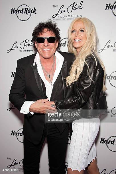 Neal Schon and wife Michaele Schon attend Les Paul's 100th Anniversary Celebration at the Hard Rock Cafe Times Square on June 9 2015 in New York City