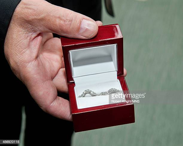Neal Schon holds a box containing the wedding bands before his wedding to Michaele Schon at the Palace of Fine Arts on December 15 2013 in San...