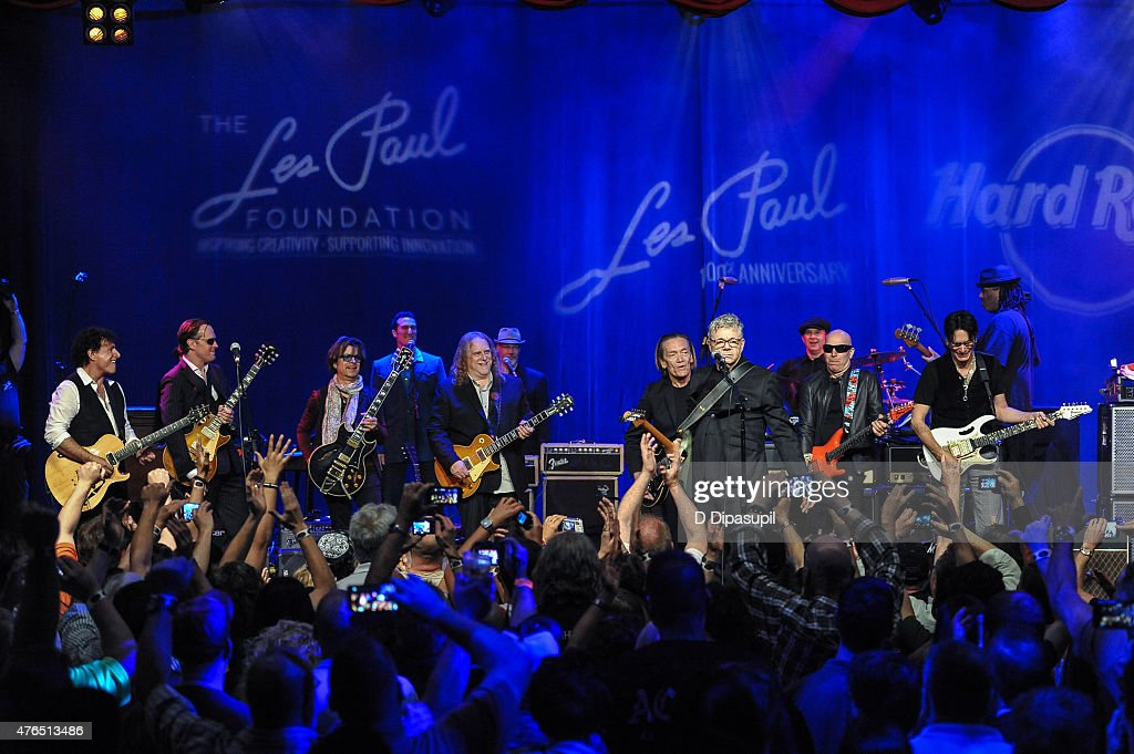 Neal Schon, Joe Bonamassa, Johnny A., Warren Haynes, G. E. Smith, Steve Miller, Joe Satriani, and Steve Vai perform onstage during Les Paul's 100th Anniversary Celebration at the Hard Rock Cafe - Times Square on June 9, 2015 in New York City.