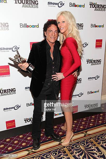 Neal Schon of Journey and Michaele Salahi attend the 2011 Billboard Touring Awards at the Roosevelt Hotel on November 10 2011 in New York City