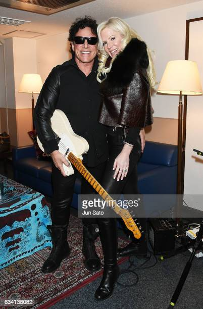 Neal Schon of Journey and Michele Schon pose for a photograph backstage at Nippon Budokan arena on February 7 2017 in Tokyo Japan