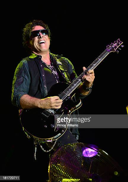 Neal Schon of Journey performs during Music Midtown 2013 Day 1 at Piedmont Park on September 20 2013 in Atlanta Georgia