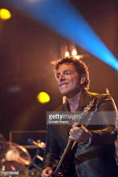 Neal Schon of Journey performs in concert at the Ovation Hall at Revel Resort Casino on August 11 2012 in Atlantic City New Jersey
